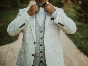 Man Adjusting Bow Tie | Simon's Formal Wear Augusta, GA | Suits - Tuxedos - Men's Formal Wear