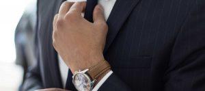 Man Adjusting Tie | Simon's Formal Wear Augusta, GA | Suits - Tuxedos - Men's Formal Wear