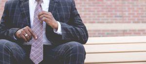 Man Holding Tie | Simon's Formal Wear Augusta, GA | Suits - Tuxedos - Men's Formal Wear